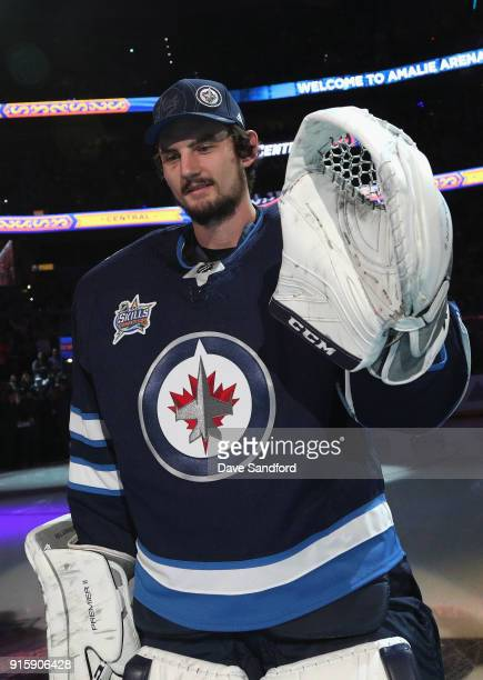 Goaltender Connor Hellebuyck of the Winnipeg Jets stands on the ice before the 2018 GEICO NHL AllStar Skills Competition at Amalie Arena on January...