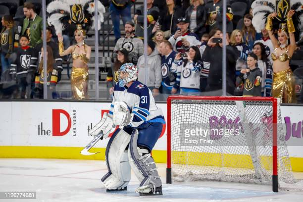 Goaltender Connor Hellebuyck of the Winnipeg Jets takes part in the pregame warm up prior to NHL action against the Vegas Golden Knights at TMobile...