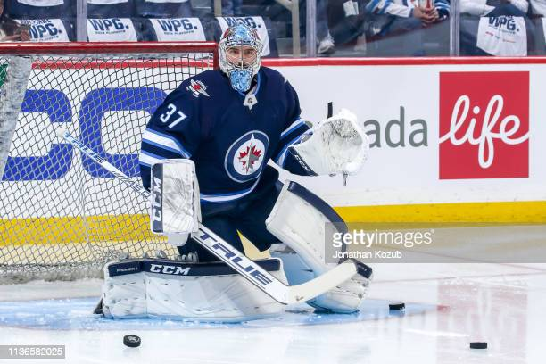 Goaltender Connor Hellebuyck of the Winnipeg Jets takes part in the pregame warm up prior to NHL action against the St Louis Blues in Game Two of the...