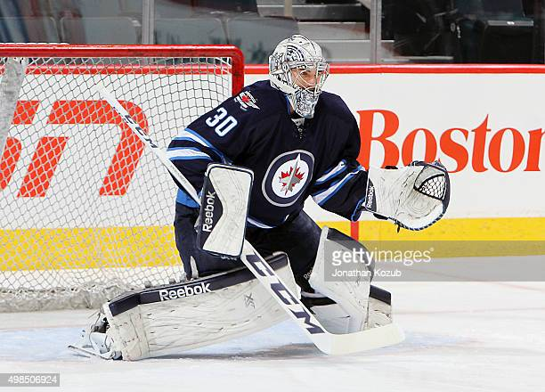 Goaltender Connor Hellebuyck of the Winnipeg Jets takes part in the pregame warm up prior to NHL action against the Colorado Avalanche at the MTS...
