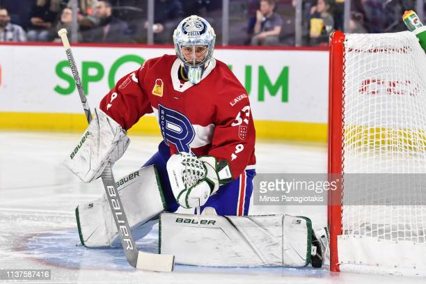 Goaltender Connor LaCouvee of the Laval Rocket protects the net against the Providence Bruins during the AHL game at Place Bell on March 20 2019 in...