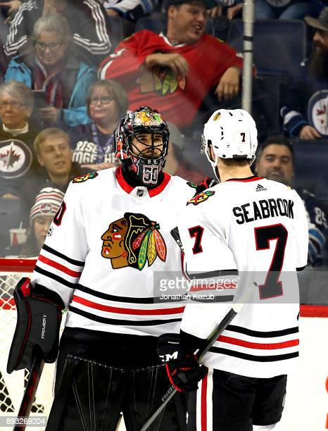 Goaltender Corey Crawford and Brent Seabrook of the Chicago Blackhawks celebrate a 51 victory over the Winnipeg Jets at the Bell MTS Place on...