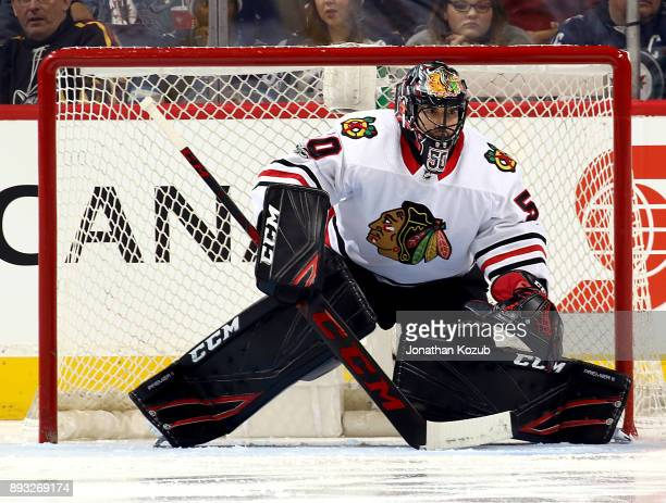 Goaltender Corey Crawford of the Chicago Blackhawks guards the net during third period action against the Winnipeg Jets at the Bell MTS Place on...