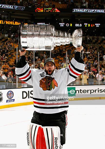 Goaltender Corey Crawford of the Chicago Blackhawks hoists the Stanley Cup after his team defeated the Boston Bruins 32 in Game Six of the 2013...