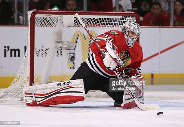 Goaltender Corey Crawford of the Chicago Blackhawks makes a save in the second period of Game One of the Western Conference Final against the Los...