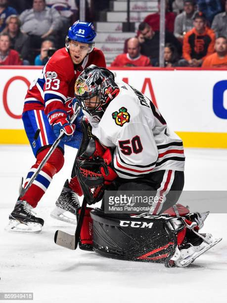 Goaltender Corey Crawford of the Chicago Blackhawks makes a save near Ales Hemsky of the Montreal Canadiens during the NHL game at the Bell Centre on...