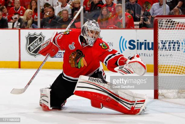 Goaltender Corey Crawford of the Chicago Blackhawks makes a save against the Boston Bruins during the first period of Game Five of the 2013 Stanley...