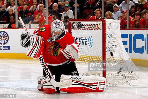 Goaltender Corey Crawford of the Chicago Blackhawks makes a save against the Boston Bruins during the third period of Game Five of the 2013 Stanley...