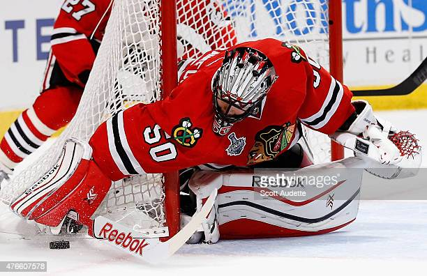Goaltender Corey Crawford of the Chicago Blackhawks makes a stick save against the Tampa Bay Lightning in the first period of Game Four of the 2015...