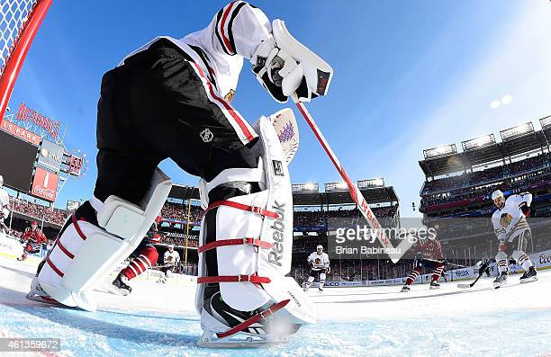 Goaltender Corey Crawford of the Chicago Blackhawks passes the puck from his crease area to defenseman Brent Seabrook during the 2015 Bridgestone NHL...