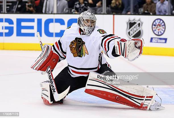Goaltender Corey Crawford of the Chicago Blackhawks reaches out for a shot wide of the net in the second period of Game Four of the Western...