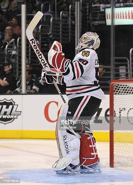Goaltender Corey Crawford of the Chicago Blackhawks reacts after a goal by teammate Marian Hossa in the third period of Game Four of the Western...