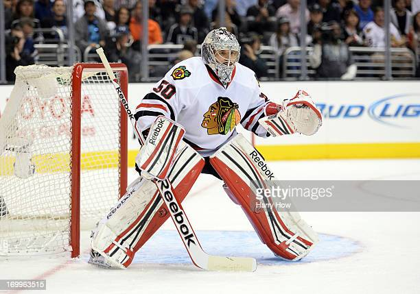 Goaltender Corey Crawford of the Chicago Blackhawks stands in position to defend his net in the second period of Game Three of the Western Conference...