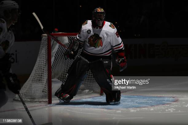 Goaltender Corey Crawford of the Chicago Blackhawks warms up during introductions prior to the game against the Colorado Avalanche at the Pepsi...