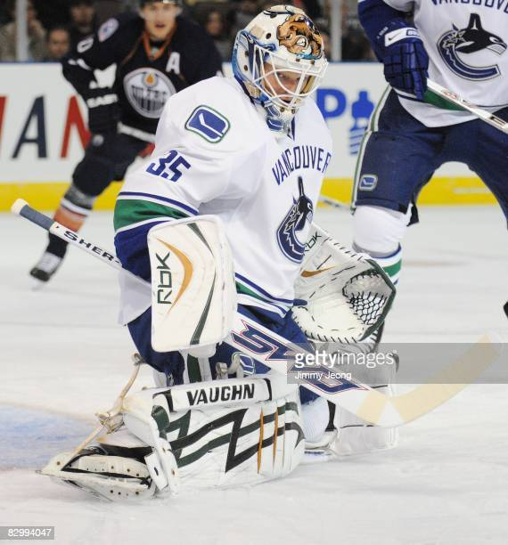 Goaltender Cory Schneider of the Vancouver Canucks eyes the puck during an NHL preseason game against the Edmonton Oilers on September 22 2008 at...