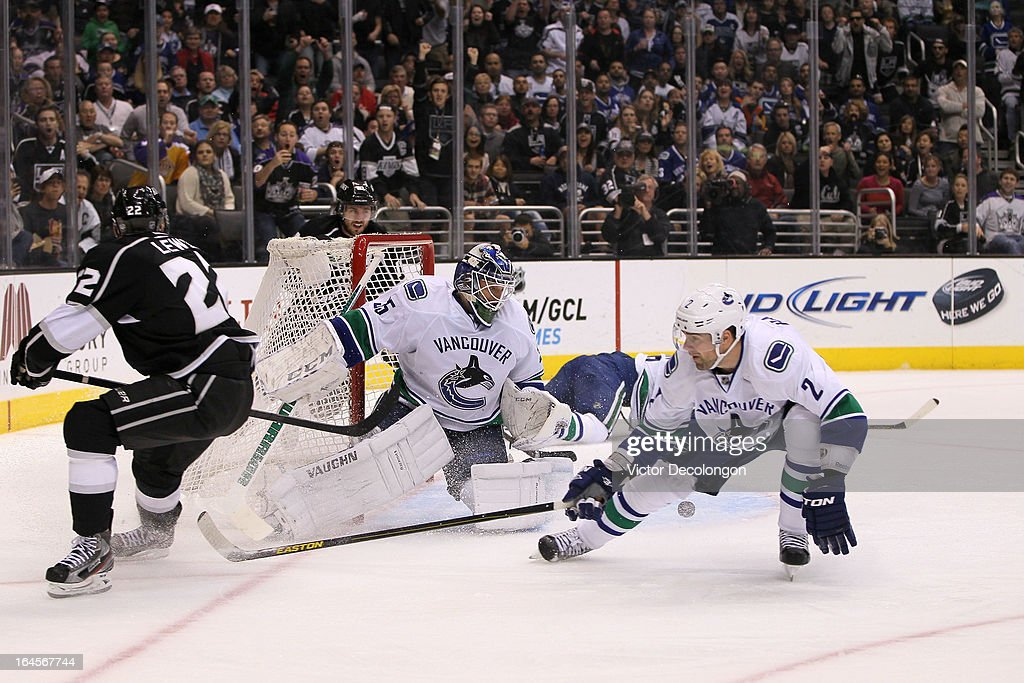 Goaltender Cory Schneider #35 of the Vancouver Canucks makes a save on a shot by Trevor Lewis #22 of the Los Angeles Kings from a two-on-one break with Mike Richards #10 of the Los Angeles Kings in the second period during their NHL game at Staples Center on March 23, 2013 in Los Angeles, California. The Canucks defeated the Kings 1-0.