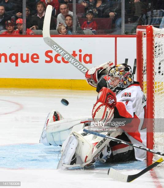 Goaltender Craig Anderson of the against the Ottawa Senators stops a shot sitting on the ice during the NHL game against the Montreal Canadiens on...