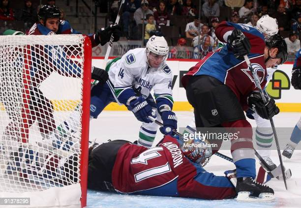 Goaltender Craig Anderson of the Colorado Avalanche blocks a shot by Alexandre Burrows of the Vancouver Canucks at the Pepsi Center on October 3 2009...
