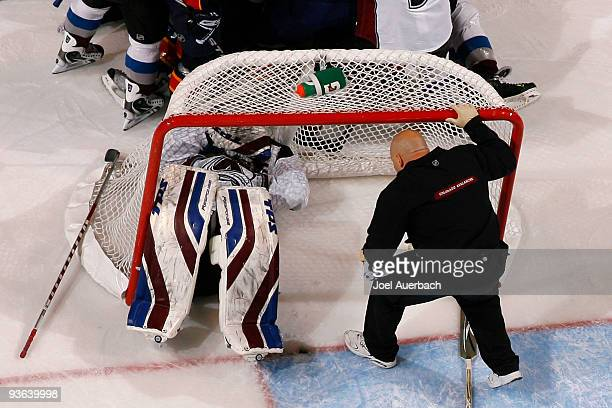 Goaltender Craig Anderson of the Colorado Avalanche lays on the ice after being injured in an collision with Keith Ballard of the Florida Panthers on...
