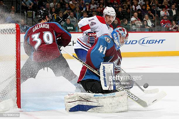 Goaltender Craig Anderson of the Colorado Avalanche makes a save against the Montreal Canadiens as T.J. Galiardi defends against Tomas Plakanec at...