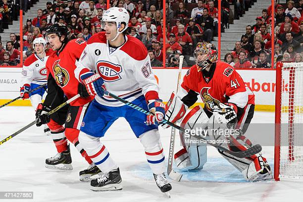 Goaltender Craig Anderson of the Ottawa Senators tries to look past Max Pacioretty of the Montreal Canadiens in Game Six of the Eastern Conference...
