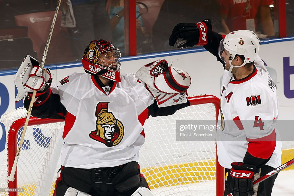 Goaltender Craig Anderson #41of the Ottawa Senators celebrates with teammate Chris Phillips #4 their 3-1 win against the Florida Panthers at the BB&T Center on January 24, 2013 in Sunrise, Florida.