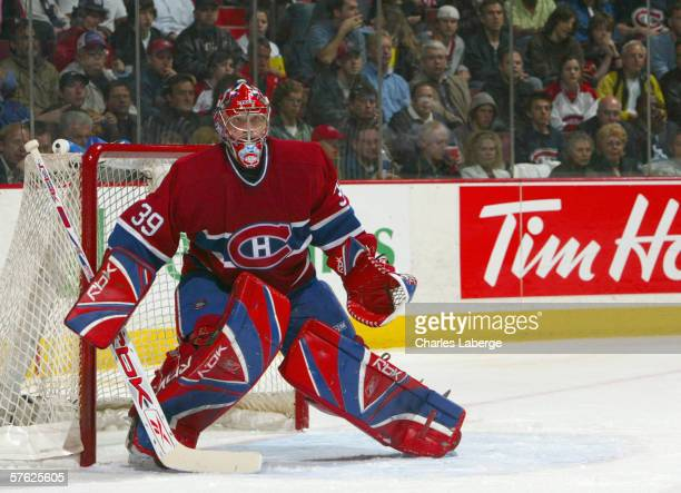 Goaltender Cristobal Huet of the Montreal Canadiens blocks the goal against the Carolina Hurricanes during game 6 of the Eastern Conference...