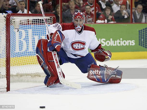 Goaltender Cristobal Huet of the Montreal Canadiens watches the puck slide away after making a stick save in the third period against the Carolina...