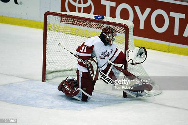 Goaltender Curtis Joseph of the Detroit Red Wings makes a glove save against the Mighty Ducks of Anaheim during the 2003 Stanley Cup playoffs at Joe...