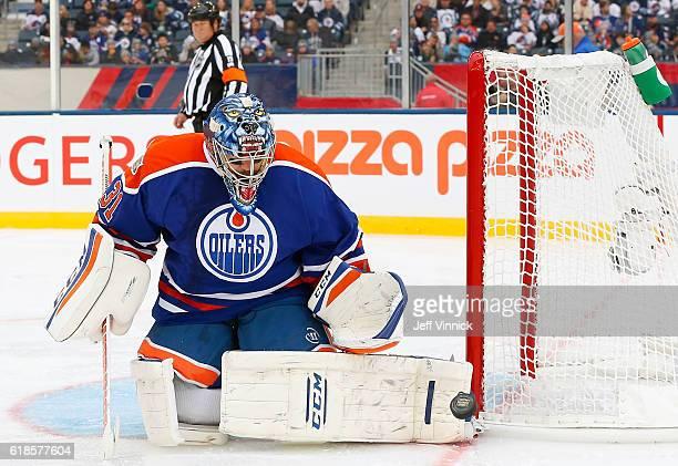 Goaltender Curtis Joseph of the Edmonton Oilers alumni blocks a shot during the 2016 Tim Hortons NHL Heritage Classic Alumni Game against the...