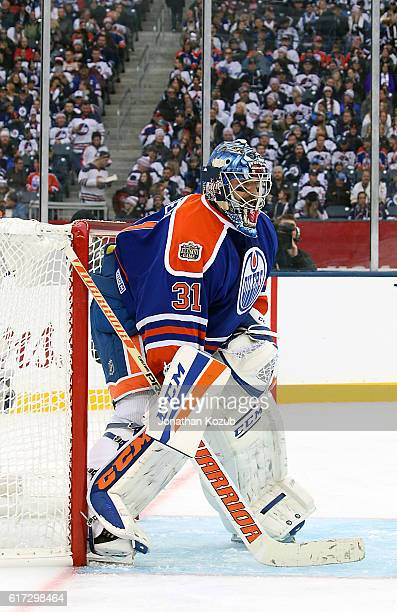 Goaltender Curtis Joseph of the Edmonton Oilers alumni guards the net during third period action against the Winnipeg Jets alumni in the 2016 Tim...