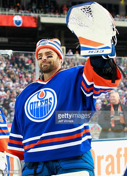 Goaltender Curtis Joseph of the Edmonton Oilers alumni team waves to the crowd during team introductions for the 2016 Tim Hortons NHL Heritage...