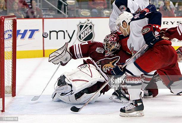 Goaltender Curtis Joseph of the Phoenix Coyotes deflects a third period shot from Gilbert Brule of the Columbus Blue Jackets on March 3 2007 at the...