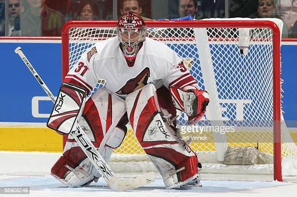 Goaltender Curtis Joseph of the Phoenix Coyotes in net against the Vancouver Canucks during the NHL game at General Motors Place on October 5 2005 in...