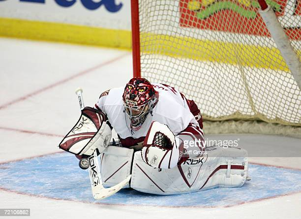 Goaltender Curtis Joseph of the Phoenix Coyotes stops the puck during the preseason game against the Anaheim Ducks at the Arrowhead Pond of Anaheim...
