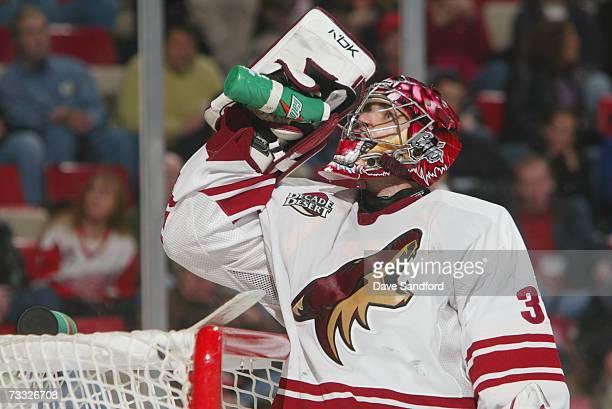 Goaltender Curtis Joseph of the Phoenix Coyotes takes a drink during a break in action of the NHL game against the Detroit Red Wings at Joe Louis...