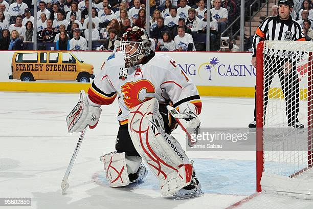 Goaltender Curtis McElhinney of the Calgary Flames defends the net against the Columbus Blue Jackets on November 28, 2009 at Nationwide Arena in...