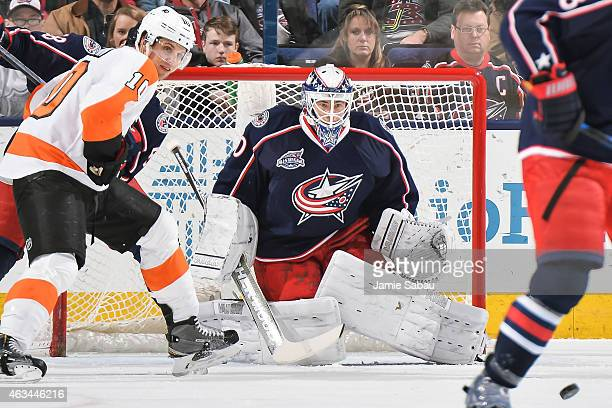 Goaltender Curtis McElhinney of the Columbus Blue Jackets defends the net against the Philadelphia Flyers on February 13 2015 at Nationwide Arena in...
