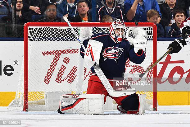 Goaltender Curtis McElhinney of the Columbus Blue Jackets fails to stop a shot during the second period of a game against the Colorado Avalanche on...