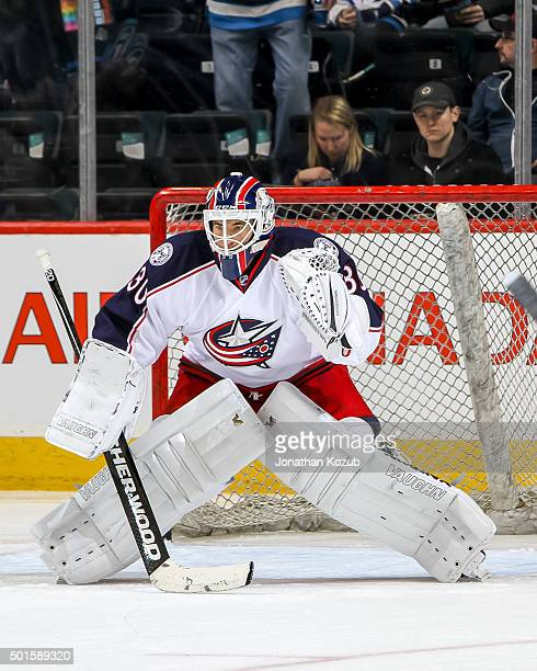 Goaltender Curtis McElhinney of the Columbus Blue Jackets takes part in the pregame warm up prior to NHL action against the Winnipeg Jets at the MTS...