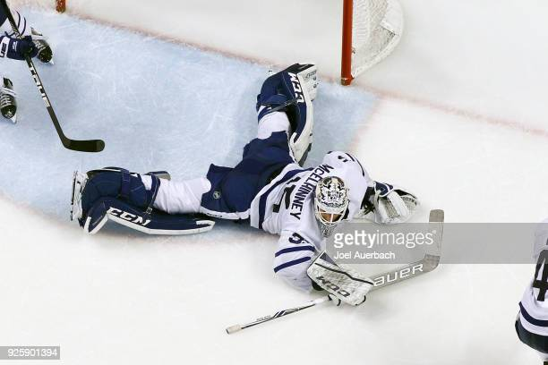 Goaltender Curtis McElhinney of the Toronto Maple Leafs sprawls on the ice to defend the net against the Florida Panthers at the BBT Center on...