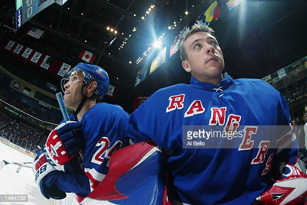 Goaltender Dan Blackburn of the New York Rangers stands on the bench next to defenseman Sylvain Lefebvre during the NHL preseason game against the...