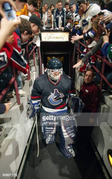 Goaltender Dan Cloutier of the Vancouver Canucks walks to the ice for the game against the Calgary Flames in the first round of the 2004 NHL Stanley...