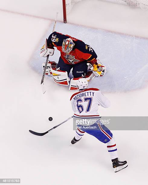 Goaltender Dan Ellis of the Florida Panthers stops a shot by Max Pacioretty of the Montreal Canadiens at the BBT Center on March 29 2014 in Sunrise...