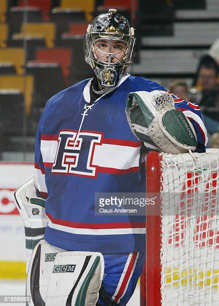 Goaltender Dan Ellis of the Hamilton Bulldogs looks on during a break in the American Hockey League game against the Cleveland Barons at Copps...