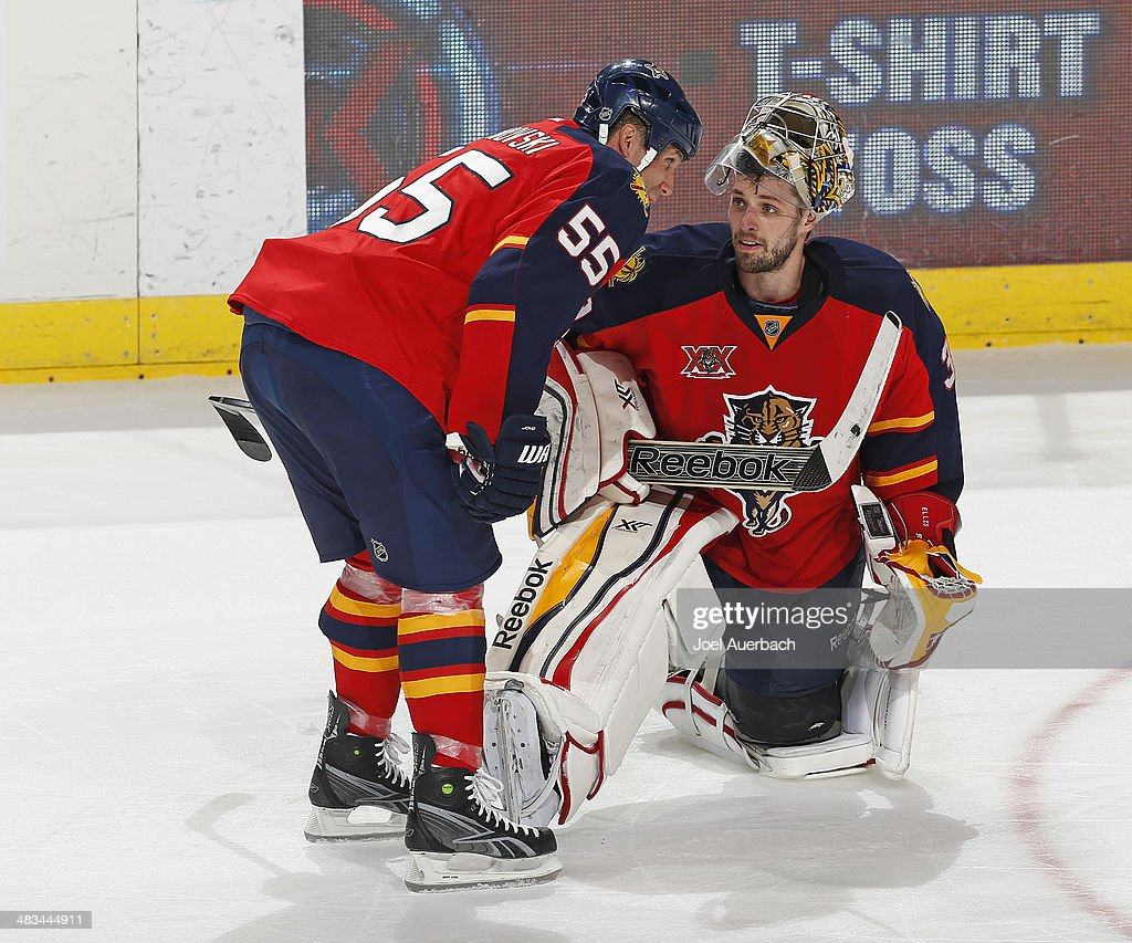 Goaltender Dan Ellis #39 talks to Ed Jovanovski #55 of the Florida Panthers during a break in action against the Philadelphia Flyers in the third period at the BB&T Center on April 8, 2014 in Sunrise, Florida. The Flyers defeated the Panthers 5-2.