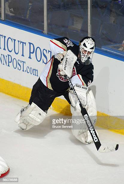 Goaltender Dany Sabourin of the WilkesBarre/Scranton Penguins plays the puck behind the net against the Bridgeport Sound Tigers at Bridgeport's Arena...