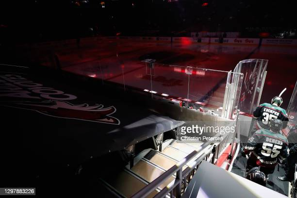 Goaltender Darcy Kuemper and Jason Demers of the Arizona Coyotes lead teammates onto the ice before the NHL game against the Vegas Golden Knights at...