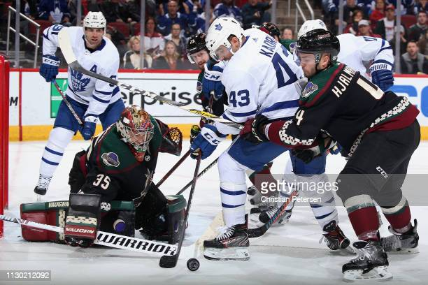 Goaltender Darcy Kuemper of the Arizona Coyotes follows the puck as Nazem Kadri of the Toronto Maple Leafs attempts a shot pressured by Niklas...