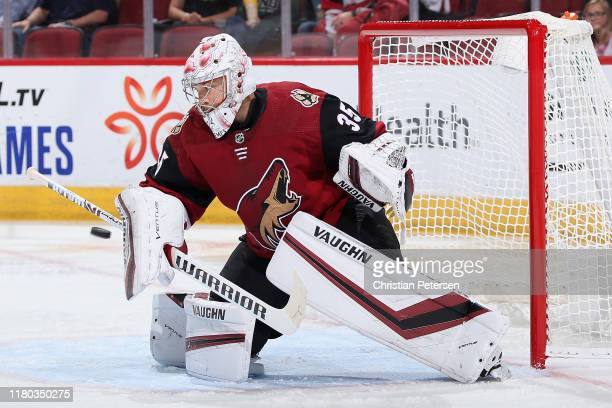 Goaltender Darcy Kuemper of the Arizona Coyotes makes a save on a shot from the Vegas Golden Knights during the second period of the NHL game at Gila...